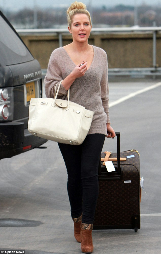 In a rush: Helen Flanagan hurried along as she arrived at Manchester airport on Monday to catch a flight to Dublin