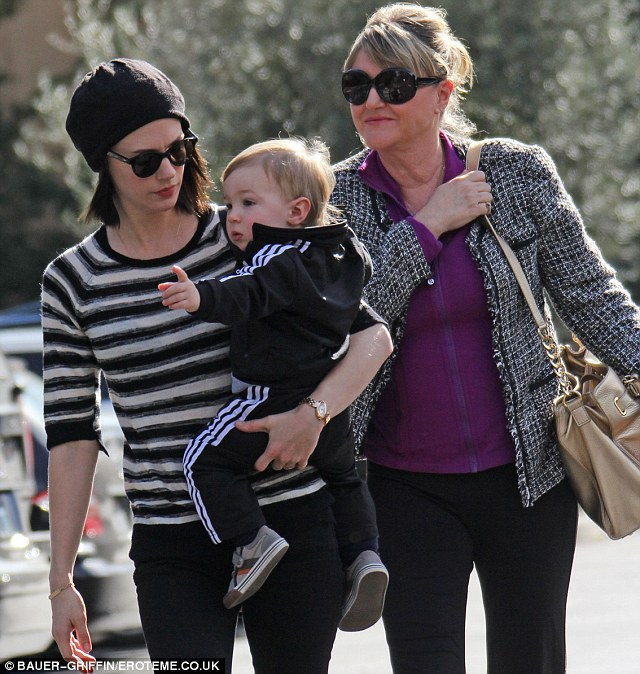 Attached at the hip: The 35-year-old carried her son as they made their way to a restaurant