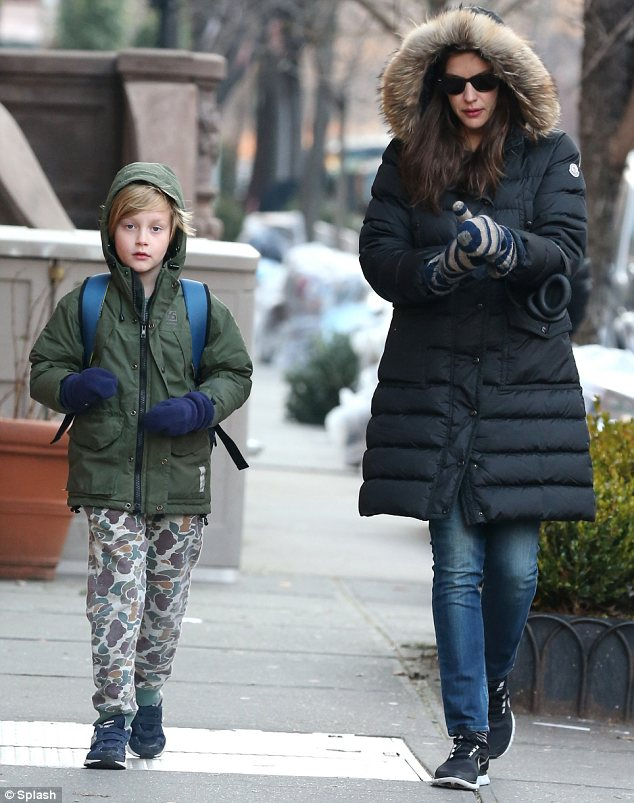 Combatting the cold: Liv and her eight-year-old son were both dressed in thick coats and cosy-looking mittens