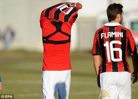 Leaving: Boateng walked off after being racially abused in a friendly for AC Milan