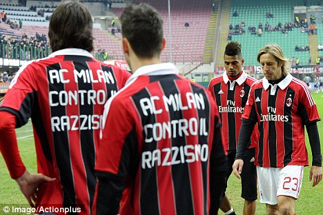 Support: Boateng and his teammates wore shirts with the 'AC Milan against racism' slogan on after the incident