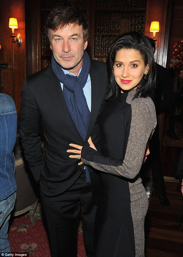 Keeping him young: Alec Baldwin looked years younger as he posed with his healthy living wife Hilaria at the Stella McCartney Autumn 2013 Presentation in New York on Tuesday night
