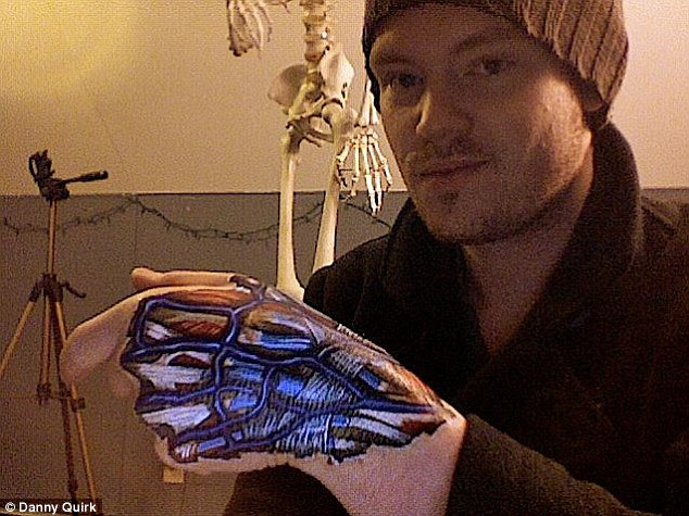Extra exposure: Danny Quirk shows off his own design drawn onto his hand using the same latex method as a way to promote his art