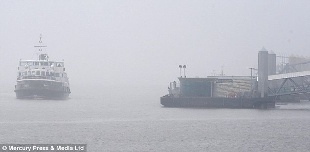 Ferry cross the Mersey: The iconic Liverpool docks were also shrouded in fog on Thursday