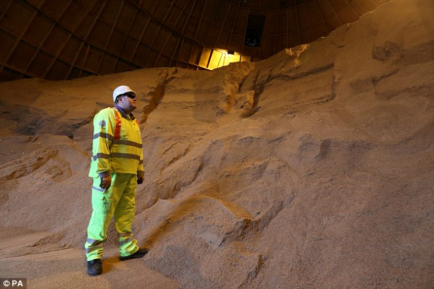 Preparation: Highways Agency maintenance operative Gary Cantellow looks at gritting salt at their South Mimms Depot in Hertfordshire
