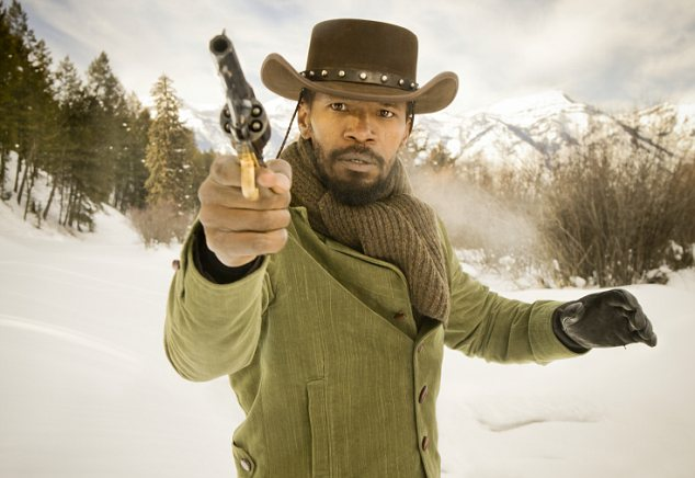 Hard hitting: Foxx stars as slave Django Freeman, who fights for his freedom and to also be reunited with his wife Broomhilda (Kerry)
