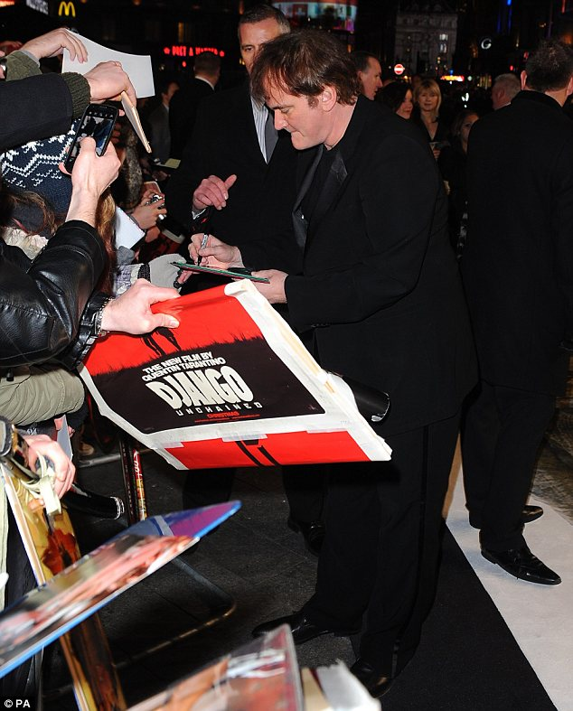 Cult hero: Quentin Tarantino was in high demand on the red carpet and fans queued to catch a glimpse of the director