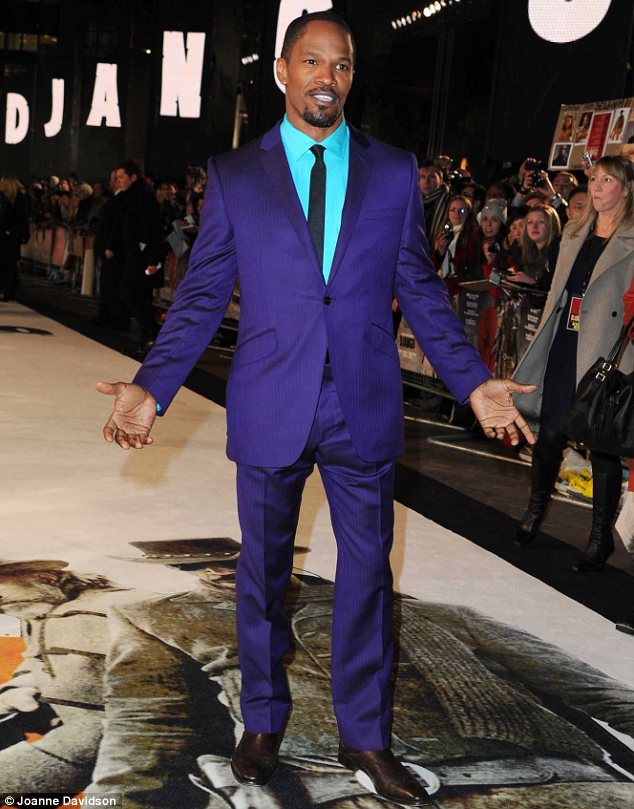 Purple haze: Jamie wasn't going to go unnoticed in a bright suit and an even bolder shirt for the occasion