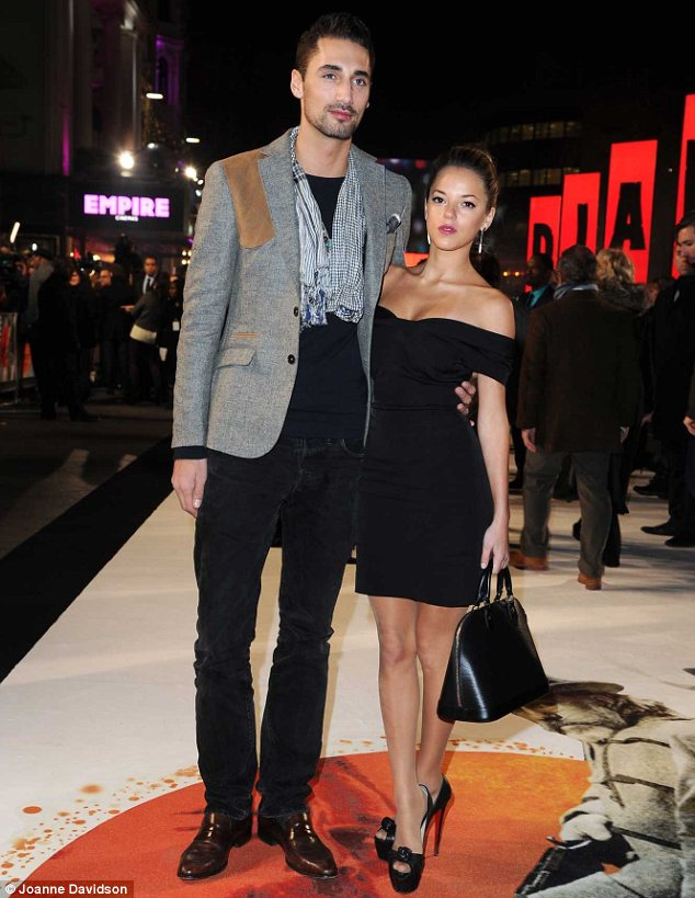 Little and large: Hugo Taylor towered above his girlfriend Natalie Joel