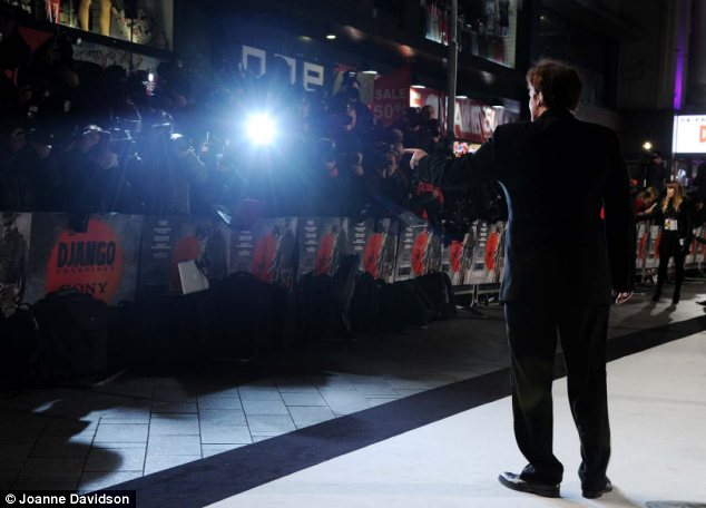 In demand: Quentin posed for photographers as he arrived on the red carpet