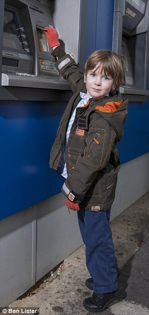 Quids in: Helen Carroll's 4-year-old son Christian at the ATM