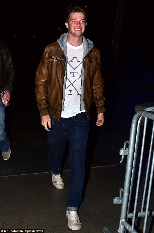 Just like his pa: Patrick Schwarzenegger walks to the Staples Center for the Los Angeles Clippers Game looking just as strapping as his dad