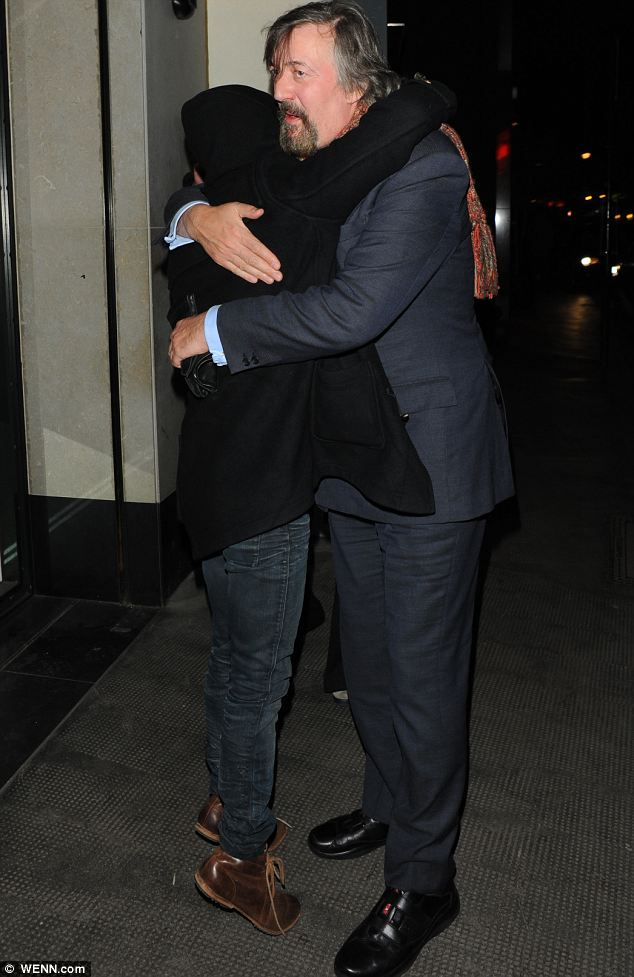 Reaching up: Daniel Radcliffe struggled to hug goodbye to Stephen Fry as they left The Ivy on Thursday evening