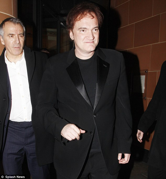 Dapper: The director looked smart in a an all black outfit with a tuxedo style jacket