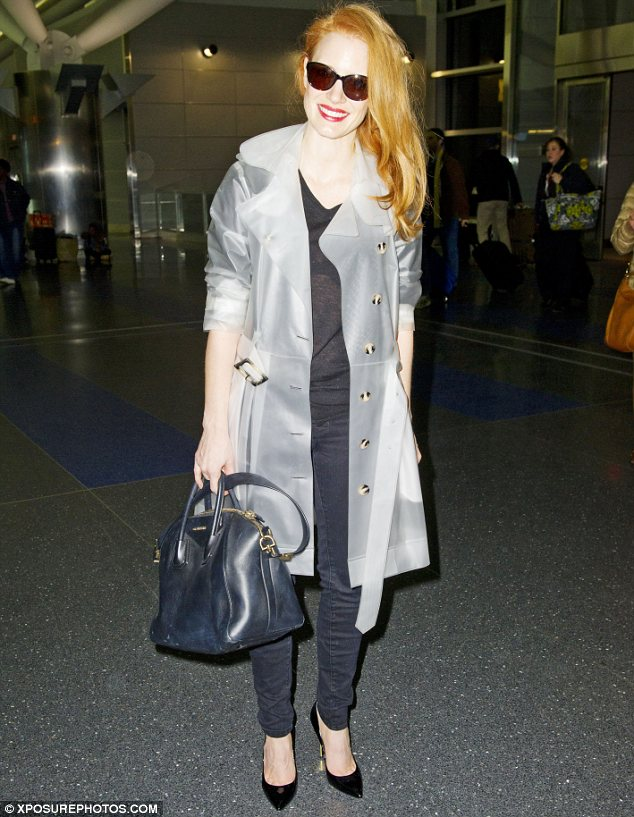 A very big grin: Jessica Chastain is up for Best Actress for her role in Zero Dark Thirty and couldn't stop smiling when she arrived in New York following the announcement