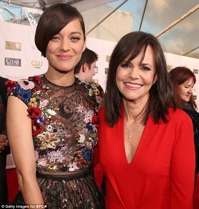 Star support: The French actress stops for a photograph with Sally Field, who was nominated for Best Supporting actress for her role in Lincoln