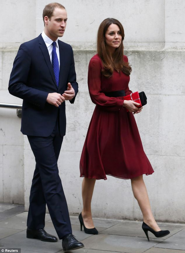Kate arrives at the National Portrait Gallery this morning for a viewing of her portrait with husband Prince William