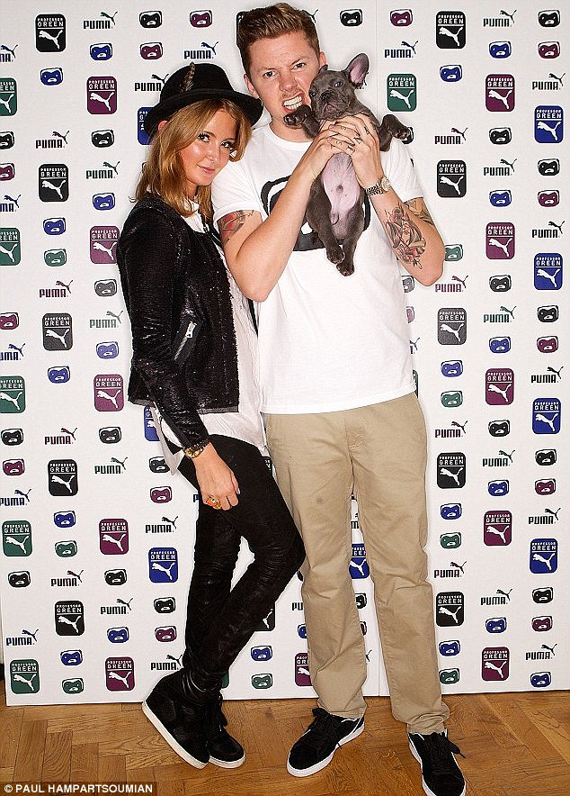 Happy couple: Millie and Professor Green, pictured with their pet dog Herbie, have been dating for just over a year
