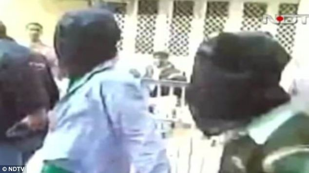 The man is one of five suspects charged with murder and rape. Here two of them can be seen led into an Indian court. If found guilty they could face the death sentence