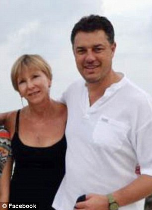 Tragic: Banker Nico Lambrechts, seen in a holiday snap with wife Adele, fell to his death at London's Coq d'Argent restaurant in October last year