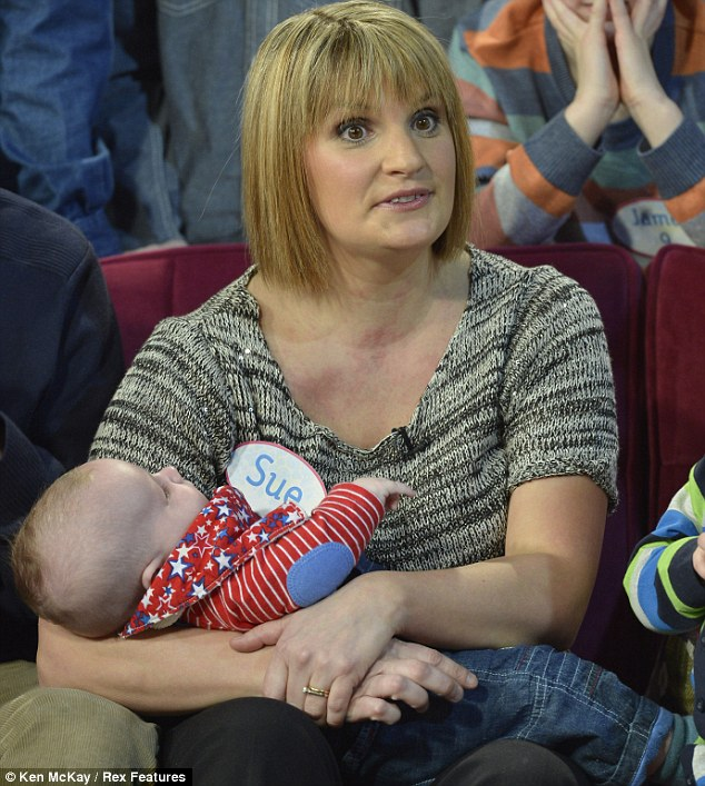 Super mum: Sue, with her youngest, baby Casper, said she loves having a big family despite stressful supermarket shops