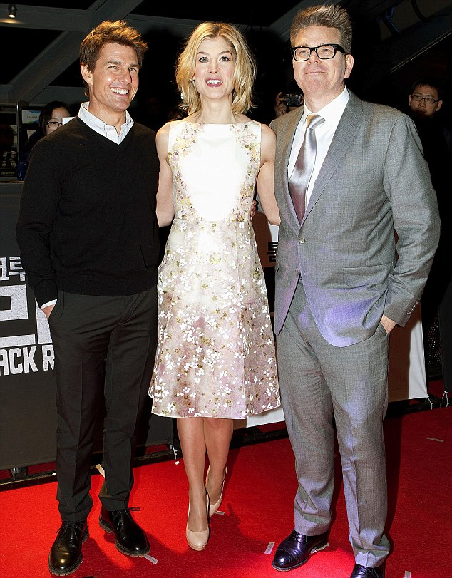 Movie star: Rosamund Pike with her Jack Reacher co-star Tom Cruise, left, and the film's writer-director, McQuarrie at the Seoul premiere of the film last night