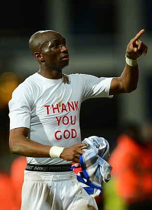 Religious man: Mbia wears a t-shirt thanking God