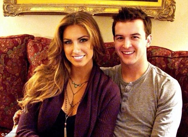 All smiles: Katherine Webb cuddles up to A.J. McCarron after becoming an internet sensation on Monday night