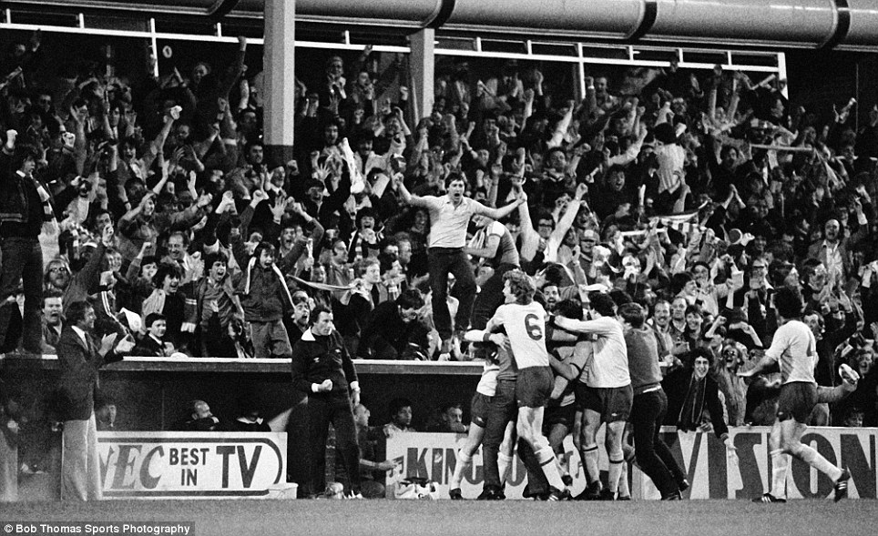 I love this picture as it illustrates the sheer joy players and fans can experience after an important goal - here it's Arsenal celebrating after Alan Sunderland's equaliser in the replay