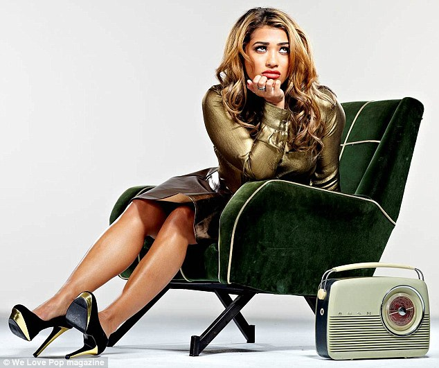 Sitting pretty: Vanessa White jokingly poses in a tantrum for the fun images as the group open up about trying to break America
