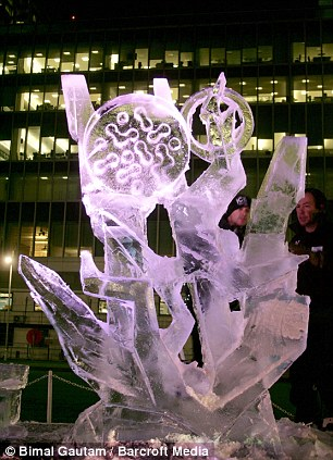 Cool hand: Ice sculptors from, all over Europe and the US have travelled to Canary Wharf to take part in the competition