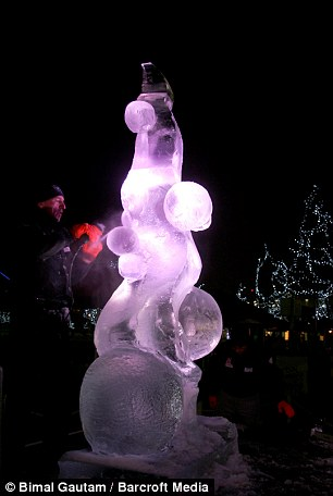 An Ice sculptor gives final touch