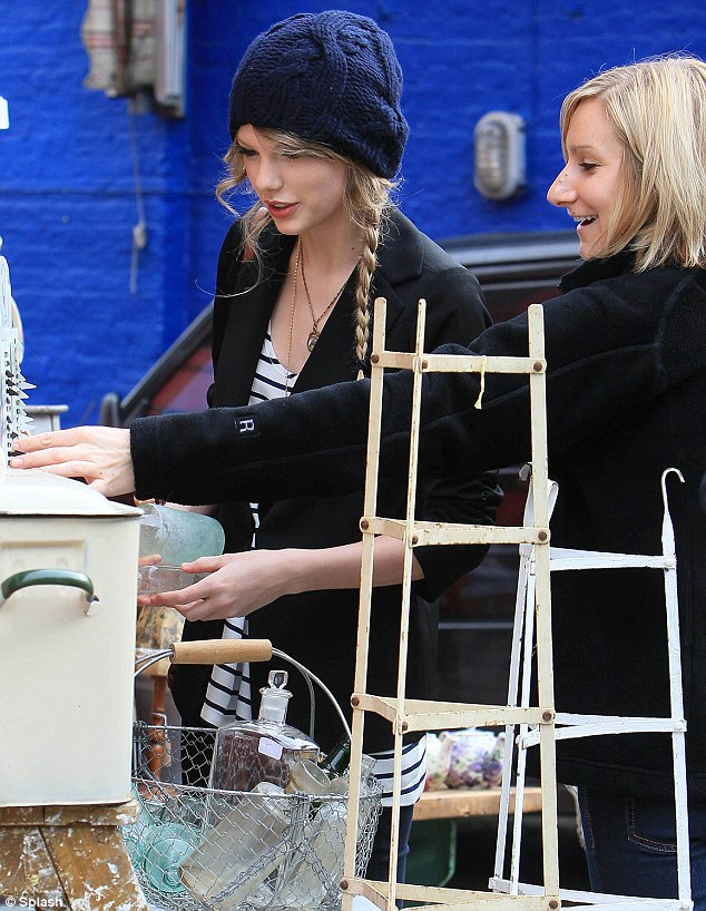 Antique fan: Taylor is a fan of all things vintage, and her less than hedonistic hobby soon bored Harry Styles, it's been alleged