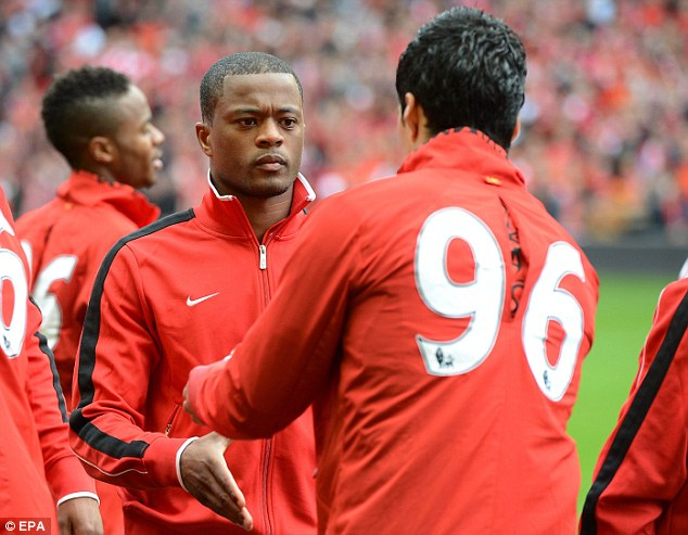 Target: Suarez isn't particularly popular with Manchester United fans after being banned for racially abusing Patrice Evra (left)
