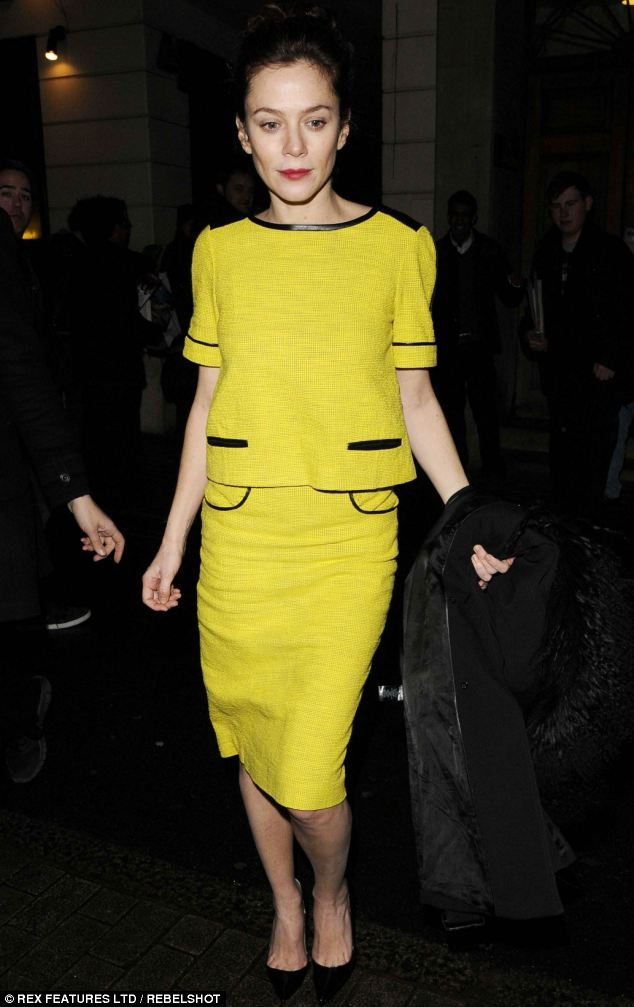 Hello sunshine! Anna Friel brightened up a dreary London evening in a bright yellow skirt suit as she left the theatre on Sunday night