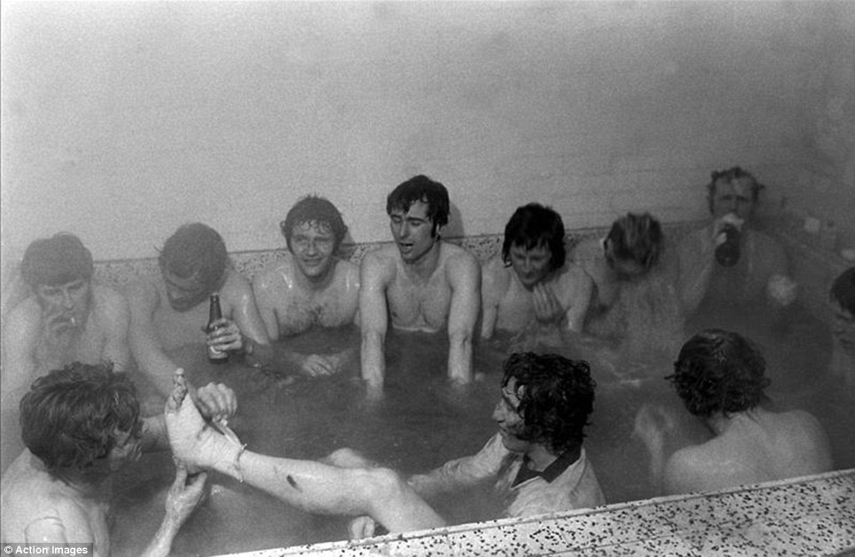 This was how to celebrate a famous cup win... bottles of beer are on the go, but so too is a cigarette if I'm not mistaken