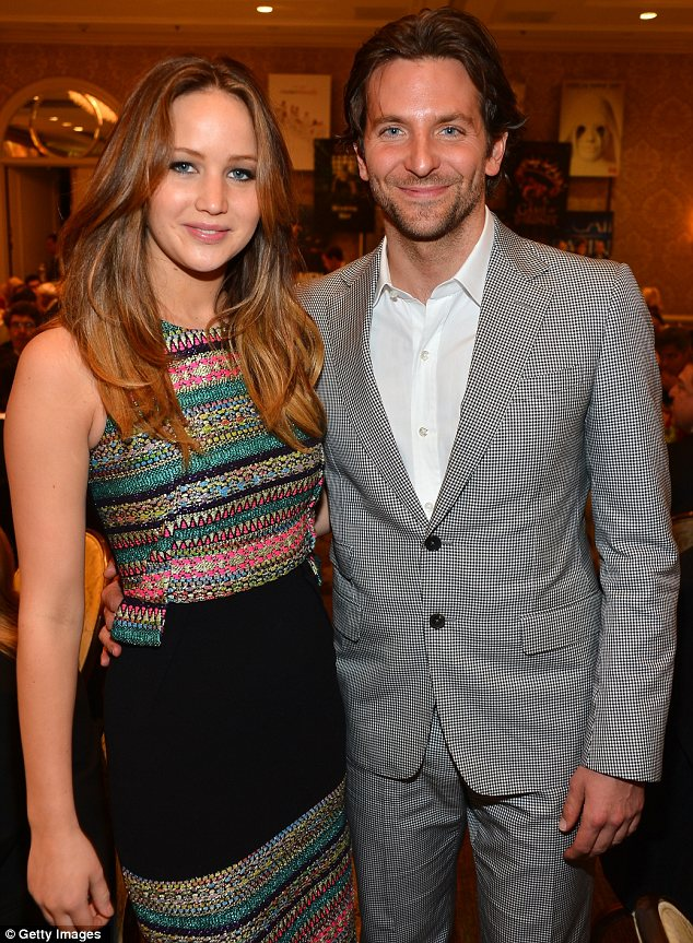 Moving on?: Meanwhile Jennifer has been sticking very close to her Silver Linings Playbook co-star Bradley Cooper, who she is pictured with on Friday