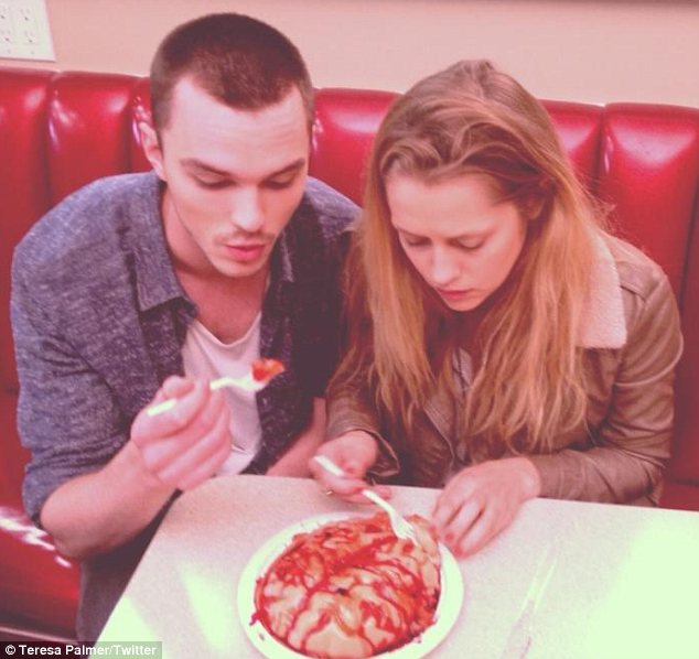 Beauty and brains: The skins star and the Australian actress pretended to tuck into a meal of brains for some Twitter photos