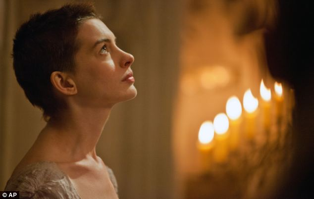 Acclaimed: Actress Anne Hathaway plays Fantine in the big screen version of Les Mis. The film has broken box office records in its first weekend