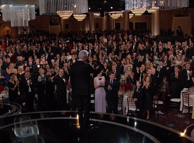 Well deserved: The entire room stood up for the former President