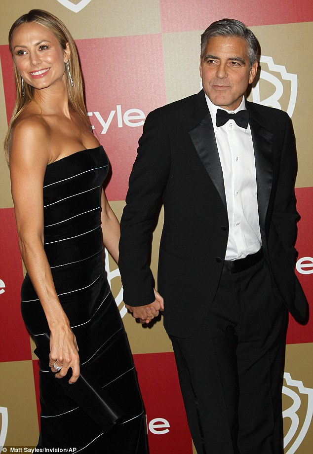 Slick duo: Stacy Keibler and George Clooney were two other big names on the guest list