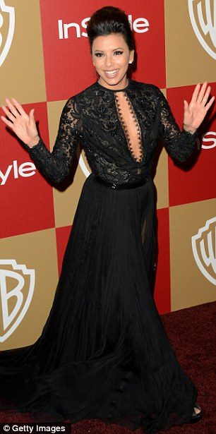 Ready to party: Eva Longoria was ready to let loose, hamming it up on the red-carpet in her revealing black Emilio Pucci dress
