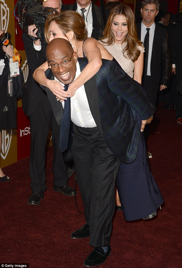 Larking around: Al Roker gave Giada De Laurentiis a piggyback ride as Maria Menounos chuckled away