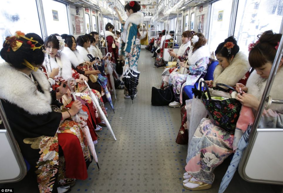 Not your average commuters: The girls look unselfconscious as they travel home on typical modes of transport after the celebration, attended by 1,200 young people