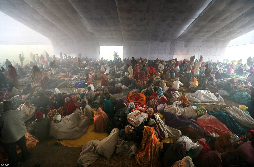 Accommodation: People take shelter in a vast makeshift hanger after arriving at the festival