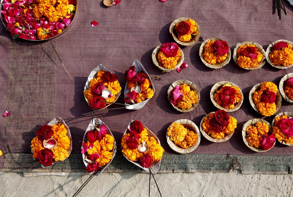 For sale: Merchants displayed floral offerings for pilgrims to send into the Ganges