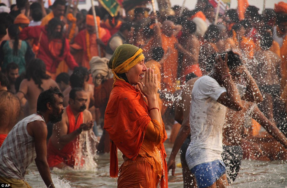 Long journey: A foreign devotee joins other pilgrims in prayer at a festival which will go on for over a month