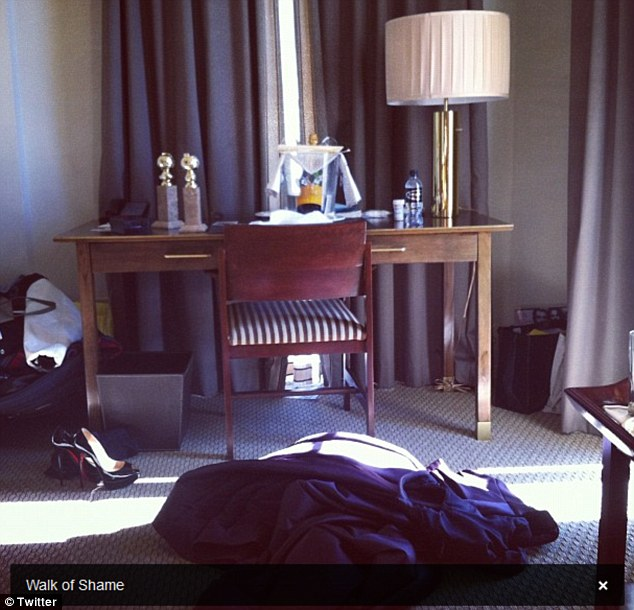 Documented: The actress and writer tweeted a picture of her gown rumpled in a pile on the floor, with her stiletto pumps next to them the morning after the awards