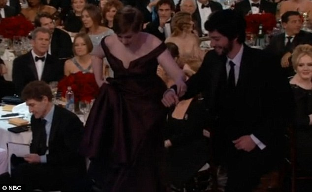 Holding on: As the 26-year-old hobbled up to the stage to accept her two awards, for Best Actress in a Comedy Series and Best Comedy Series for her hit show Girls, she could barely make it across the stage