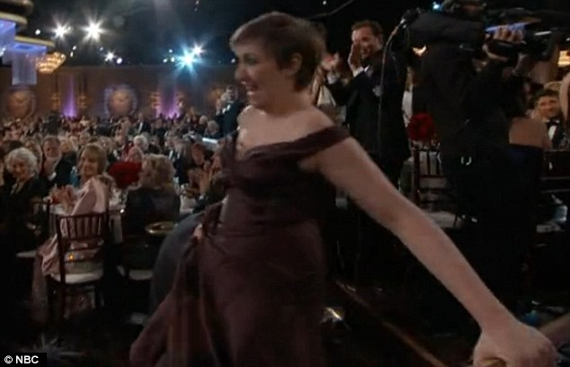 Grand exit: As the writer and actress precariously made her way off the stage, Twitter exploded with commentary about her inability to walk in the platforms